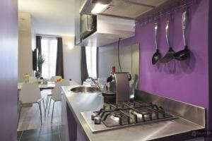 A kitchen or kitchenette at Le Marais Apartments