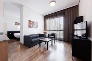 Гостиная зона в Compostela Suites