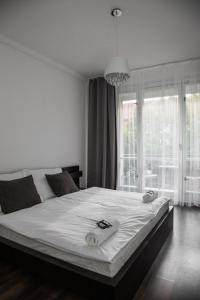 A bed or beds in a room at Apartment Kosicka