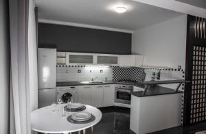 A kitchen or kitchenette at Apartment Kosicka