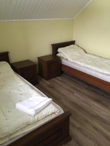 """A bed or beds in a room at Country House in Horse Park """"Rus'"""""""