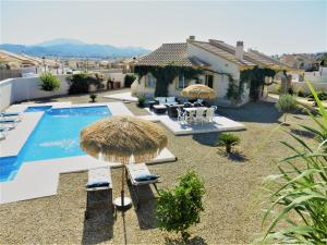 A view of the pool at The Olive Tree Villa or nearby