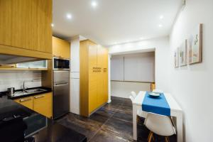 A kitchen or kitchenette at T4 Luís