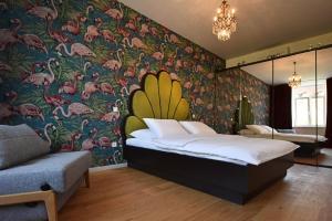 Postelja oz. postelje v sobi nastanitve Apartmaji Tromostovje