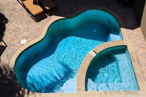 Vue sur la piscine de l'établissement 7596 Reunion Resort 4 Bedroom Villa ou sur une piscine à proximité