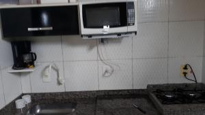 A kitchen or kitchenette at Residencial Brisa do Peró