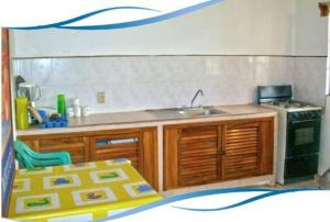 A kitchen or kitchenette at Bungalows La Playa