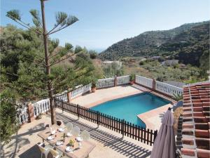 A view of the pool at Three-Bedroom Holiday Home in Torrox or nearby