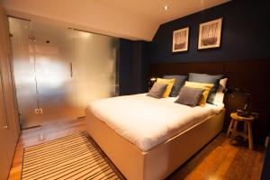 A bed or beds in a room at Soho Residences by Allô Housing