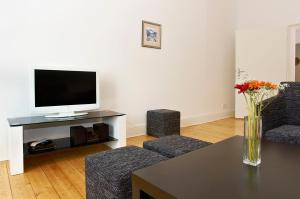 A television and/or entertainment center at BerlinLux Apartments - City West