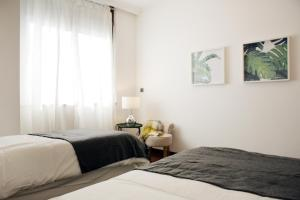 A bed or beds in a room at Parque das Nações - Fil Pool Apartment