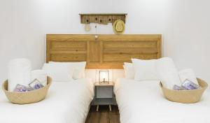 A bed or beds in a room at Charming Madrid Center