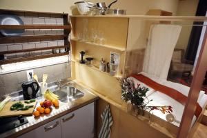 A kitchen or kitchenette at WANZ'inn Design Appartements