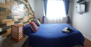 A bed or beds in a room at Departamento Mall Antofagasta