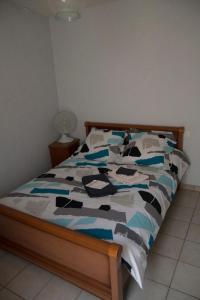 Un ou plusieurs lits dans un hébergement de l'établissement Appartement Maury