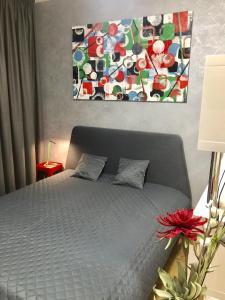 Кровать или кровати в номере Matilda apartment U MUZEA