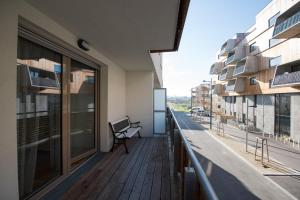 A balcony or terrace at FeelGood Apartments Seestadt Vienna