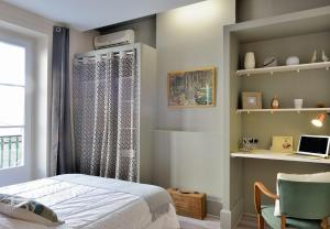 A bed or beds in a room at Gambetta #4 - Appartement cosy - 2 personnes