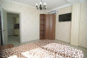 Krevet ili kreveti u jedinici u okviru objekta Apartment on Parkovaya 6