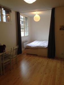 Un ou plusieurs lits dans un hébergement de l'établissement studio 40m2
