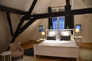 A bed or beds in a room at Spacious Duplex App. Centre Bruges