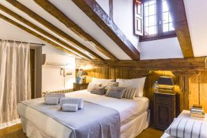 Säng eller sängar i ett rum på Sweet Inn Apartment - Redondilla