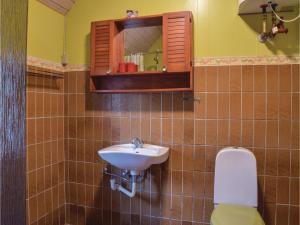 A bathroom at Holiday home Tyttebærvej Ulfborg XII