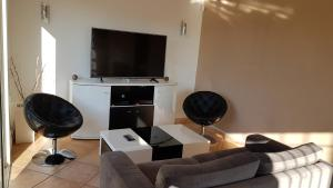 A television and/or entertainment center at Staali Apartment