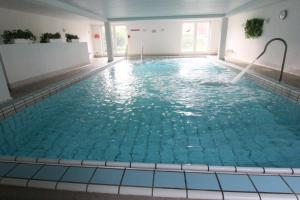The swimming pool at or near Residenz Albatros