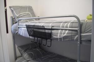 Un ou plusieurs lits superposés dans un hébergement de l'établissement Bel appart modern au pied du grand Veymont