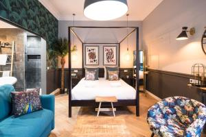 A bed or beds in a room at FLAAT- CHAMPS ELYSEES II