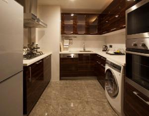 Küche/Küchenzeile in der Unterkunft Lee Garden Service Apartment