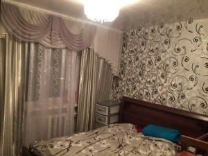 A bed or beds in a room at Apartment on Nadibaidze 3