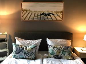 A bed or beds in a room at Designerwohnung, 4 Zimmer, Sternschanze