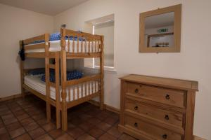 A bunk bed or bunk beds in a room at Black Isle Bunkhouse