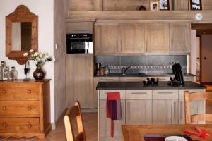Cuisine ou kitchenette dans l'établissement CGH Résidences & Spas Le Télémark