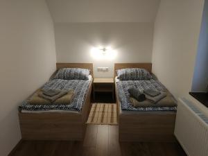 Postelja oz. postelje v sobi nastanitve Apartment KLEMEN