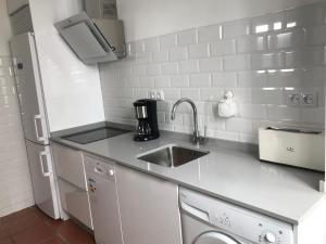 A kitchen or kitchenette at 117 de LaLatina