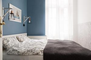 Postelja oz. postelje v sobi nastanitve Cosy Central Apartment
