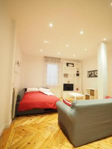 A bed or beds in a room at Elegante piso en calle Goya