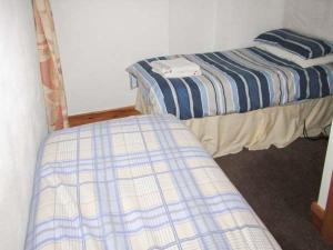 A bed or beds in a room at Copper Miner's Cottage