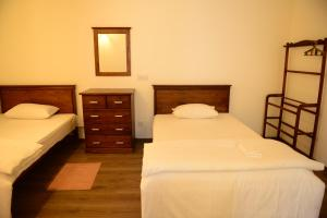 A bed or beds in a room at City Square Service Apartments