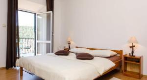 Łóżko lub łóżka w pokoju w obiekcie Apartments Linda