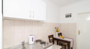 Kuchnia lub aneks kuchenny w obiekcie Apartments Linda