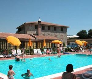 The swimming pool at or near Villaggio Residence La Pieve di Pomaia