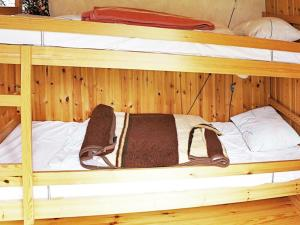 A bunk bed or bunk beds in a room at One-Bedroom Holiday home in Borensberg
