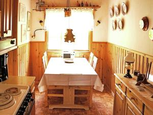 A kitchen or kitchenette at One-Bedroom Holiday home in Borensberg