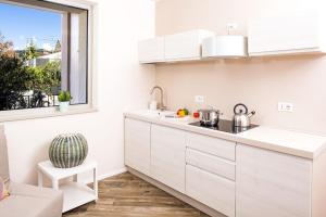 A kitchen or kitchenette at Bardolino center ground floor with pool and garden