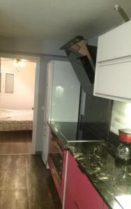 A kitchen or kitchenette at Apartamento Laguna
