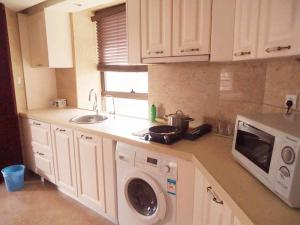 A kitchen or kitchenette at Ziyuan Service Apartment
